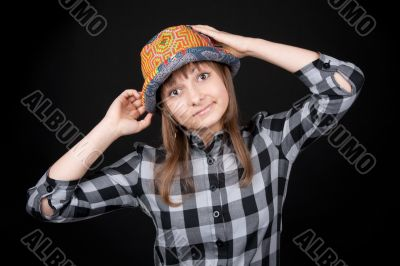 Beautiful girl in colour hat