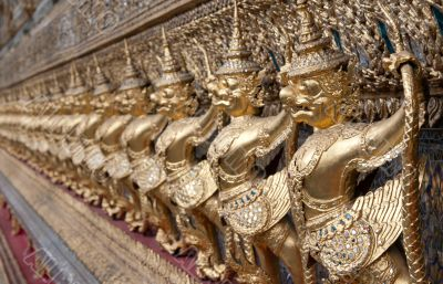 Golden figures warrior in royal palace