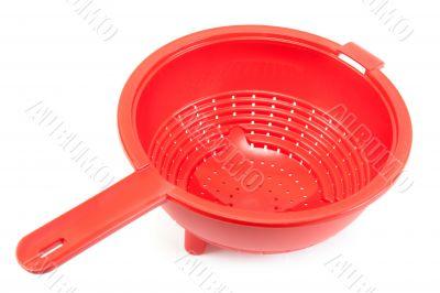 Red brilliant plastic colander