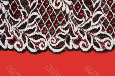 Black lace insulated on red background