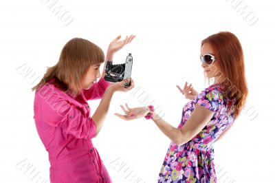 Two girls are taken pictures