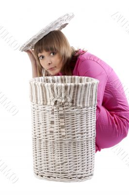 Girl peers out for baskets for linen