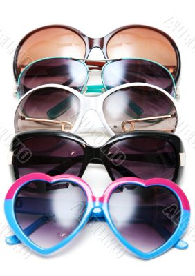 Much sunglasseses put in row
