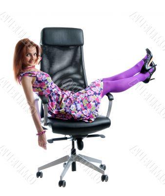 Beautiful girl on black easy chair