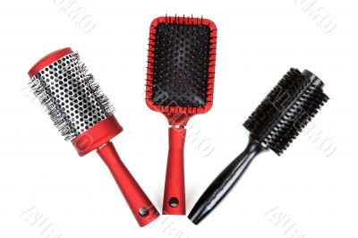 Three red massages comb on white background
