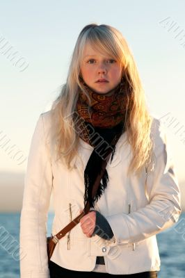 Beautiful blonde on background blue sky