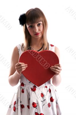 Beautiful girl in gown with red colour and heart in hand