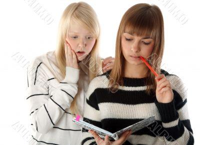 Two beautiful girls read diary book