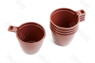 Five brown plastic cups