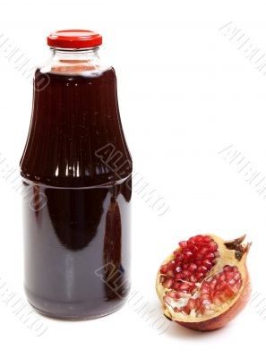 Bottle of juice and ripe piece grenade