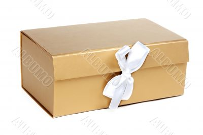 Golden gift box with a bow