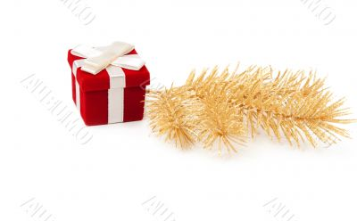 Red and gold gift box with fir branches