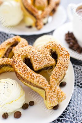 heart-shaped pastry with sesame seeds