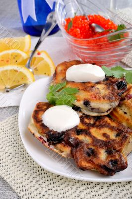 Fried pancakes with blackcurrant