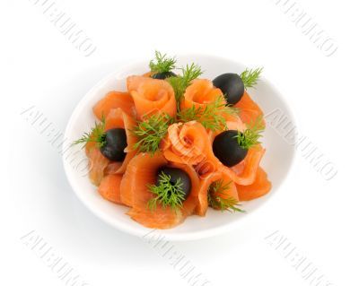 Appetizer of salmon with fennel and olives on a white background