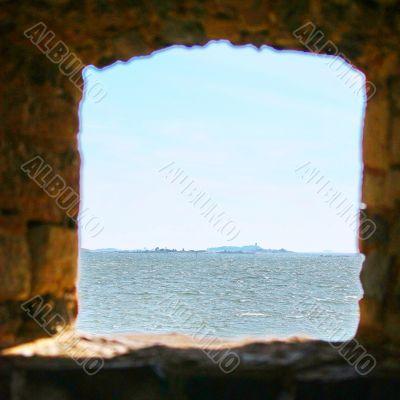 Window in stone wall of Suomenlinna Sveaborg Fortress in Helsink