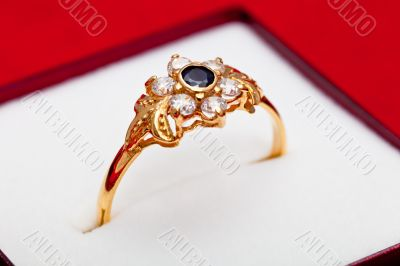 Gold ring with white and blue zirconia enchased