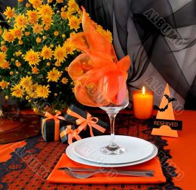 Festive table with gifts for Halloween