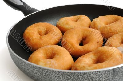 Donuts in a frying pan