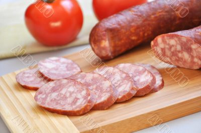 Mouth-watering smoked sausage and ripe tomatoes