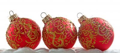 Christmas decoration, the red balls isolated on white