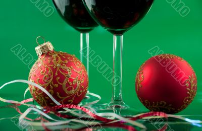 New Year`s still life - glasses of wine and Christmas balls