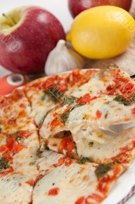 Appetizing pizza with mozzarella cheese and fruit