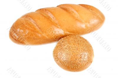 Sliced bread and bun with sesame seeds