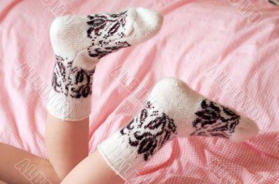 Children`s feet in wool socks
