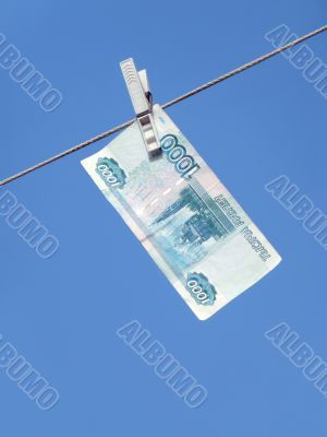 Russian money hanging on the clothesline. Money laundering