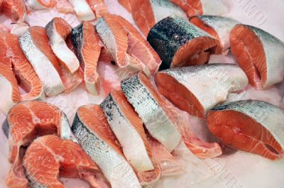 Fresh salmon steaks in the shop