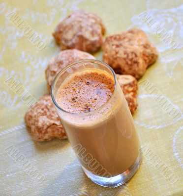 A delicious chocolate drink with biscuits