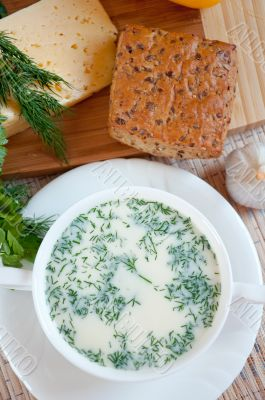 Cheese soup with dill and cereal bread