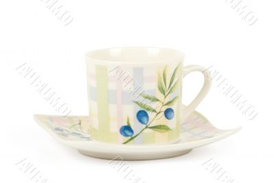 Fine china cup and saucer filled  isolated on white