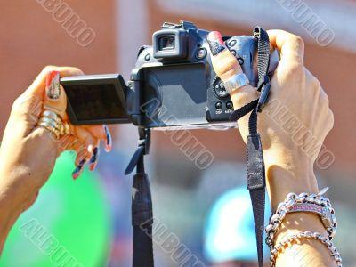 Camera in women`s hands