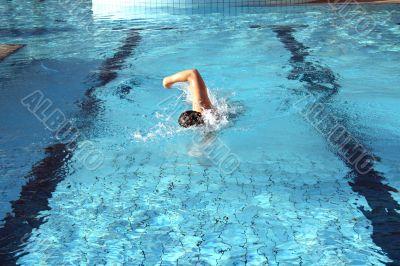 a man learn swim the crawl in pool