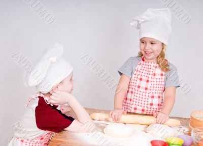 girl and boy  in chef`s hats