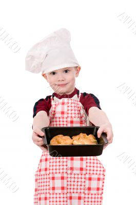 boy in chef`s hat with baking