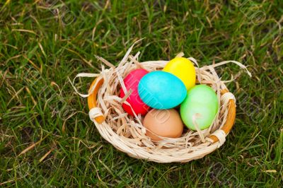 Basket with the colorful Easter eggs