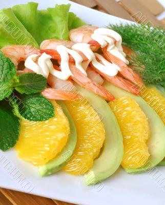 Appetizer of avocado and shrimp with orange