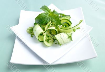 Cucumber salad with greens and sesame