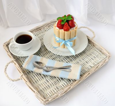 Dessert souffle with biscuit and fresh strawberries and a cup of