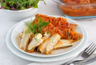 Baked fish in tomato sauce with vegetables