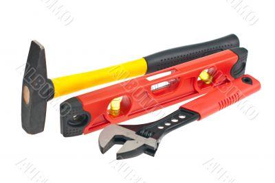 hammer, spirit level, a wrench