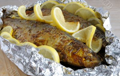 Baked herring in spices and herbs in foil