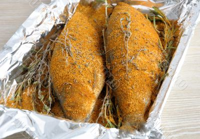 Herring in spices and herbs in foil