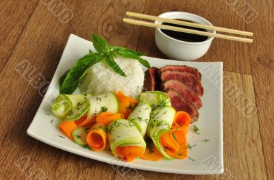 Veal meat with the blood with rice and vegetables