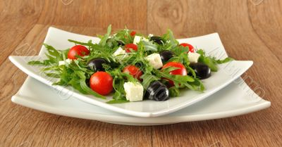 Salad of arugula with cherry tomatoes and grapes
