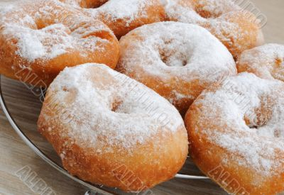 Fried donuts in powdered sugar closeup