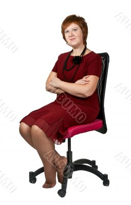middle-aged woman in a chair